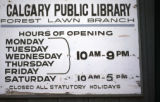 Forest Lawn Library, open hours sign